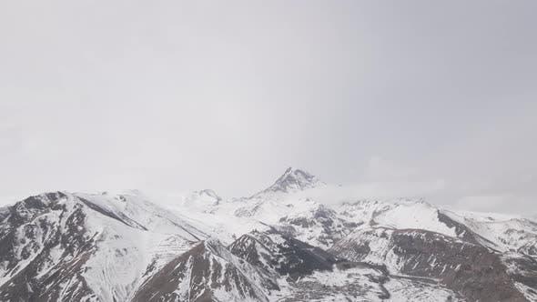 Aerial view of beautiful snowy mountains in Stepantsminda