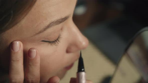 Makeup Artist Applying Eyeliner To Waterline By Using Eyeliner Brush for Making Perfect Makeup