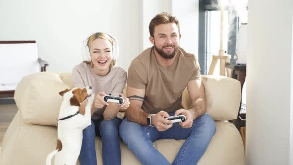 Portrait of Two Friends Playing Video Games at Home