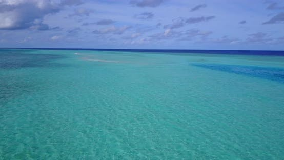 Thumbnail for Daytime overhead tourism shot of a white sandy paradise beach and aqua blue water background