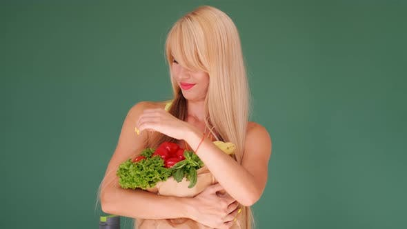Thumbnail for Beautiful Woman with a Bunch of Healthy Eating