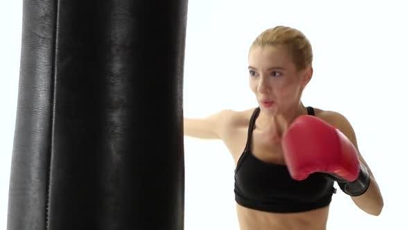 Thumbnail for Muscular Blond Girl Boxer with Cries Kicking Punching Bag