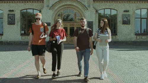 Students Walking and Communicating in Campus
