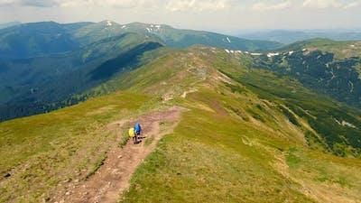 Two Tourists Descend the Montenegrin Ridge