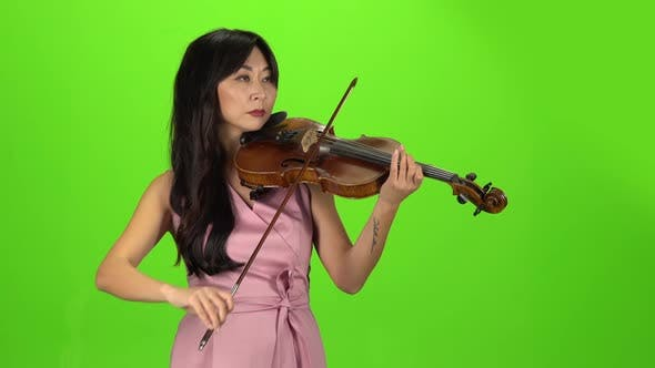Girl of Asian Appearance Playing the Violin