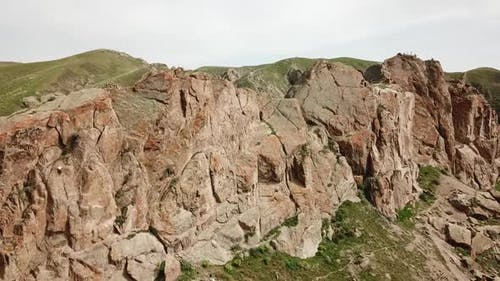 A Man Climbs Up the Cliff