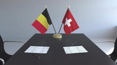 Flags of Belgium and Switzerland and Papers
