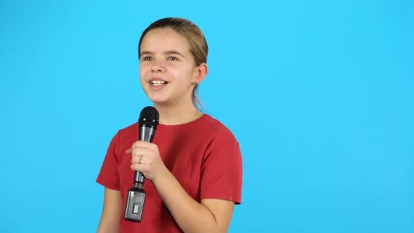 Cute Toddler with Microphone