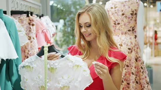 Thumbnail for Woman Searching Dress in Shop