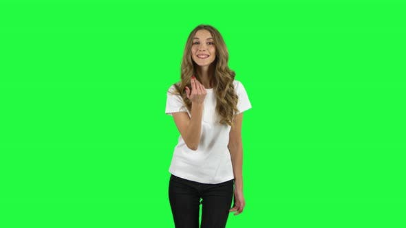 Cover Image for Lovable Girl Waving Hand and Showing Gesture Come Here. Green Screen