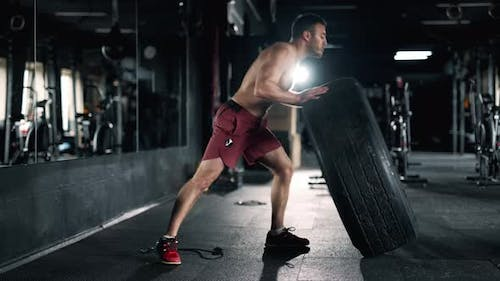 A Muscular Sportsman is Doing Exercise