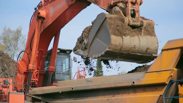 Thumbnail for Close-up Red Excavator Loads Tipper Truck