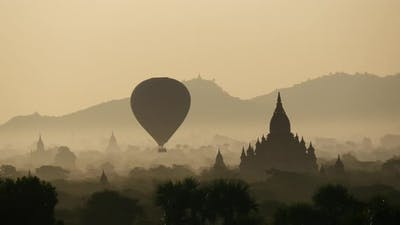Balloon flying during sunrise over the Pagodas