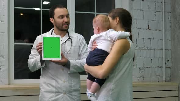 Thumbnail for Doctor Showing Mother and Her Kid Medical Results on the Tablet