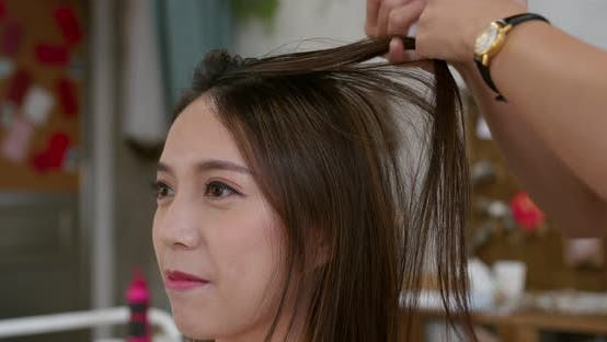Thumbnail for Hairdresser creating a hairstyle for bride in salon