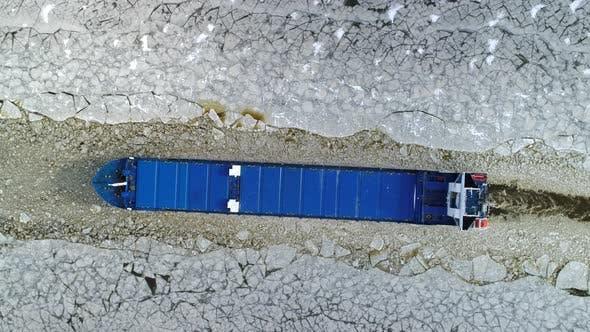 Thumbnail for Cargo Ship Sailing Through Ice Aerial Top Down