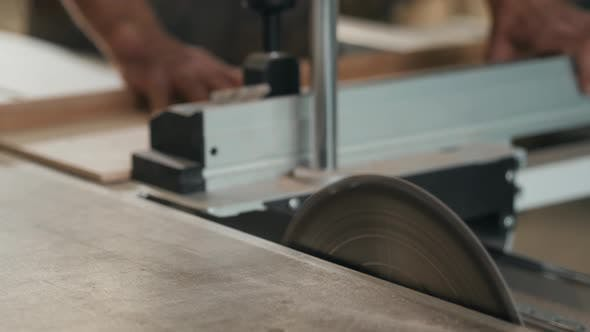 Cover Image for Saws Furniture Details with a Circular Saw. Close Up View of Man Wooden Production Factory Furniture