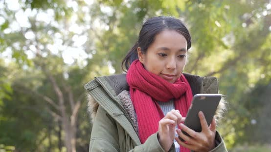 Thumbnail for Woman use of mobile phone in citypark