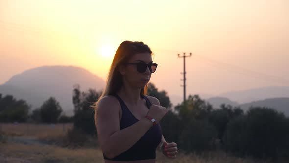 Thumbnail for Sporty Girl Jogging in Country Road at Sunset. Young Woman Running Outdoors. Healthy Active