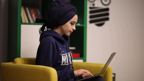 Cover Image for Businesswoman Working On Laptop