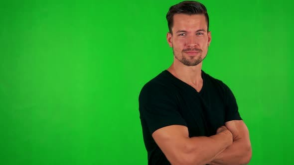 Thumbnail for Young Handsome Caucasian Man Does Poses To Camera - Green Screen - Studio