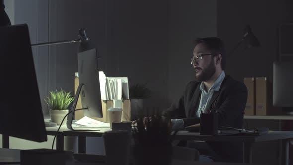 Man Finishing Report at Night before Deadline