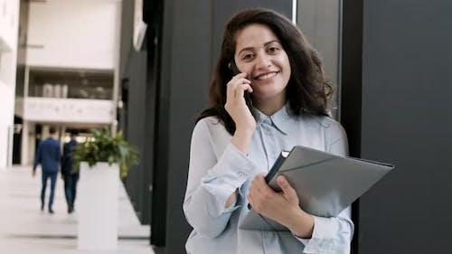 Portrait of Beautiful Businesswoman Using Telephone