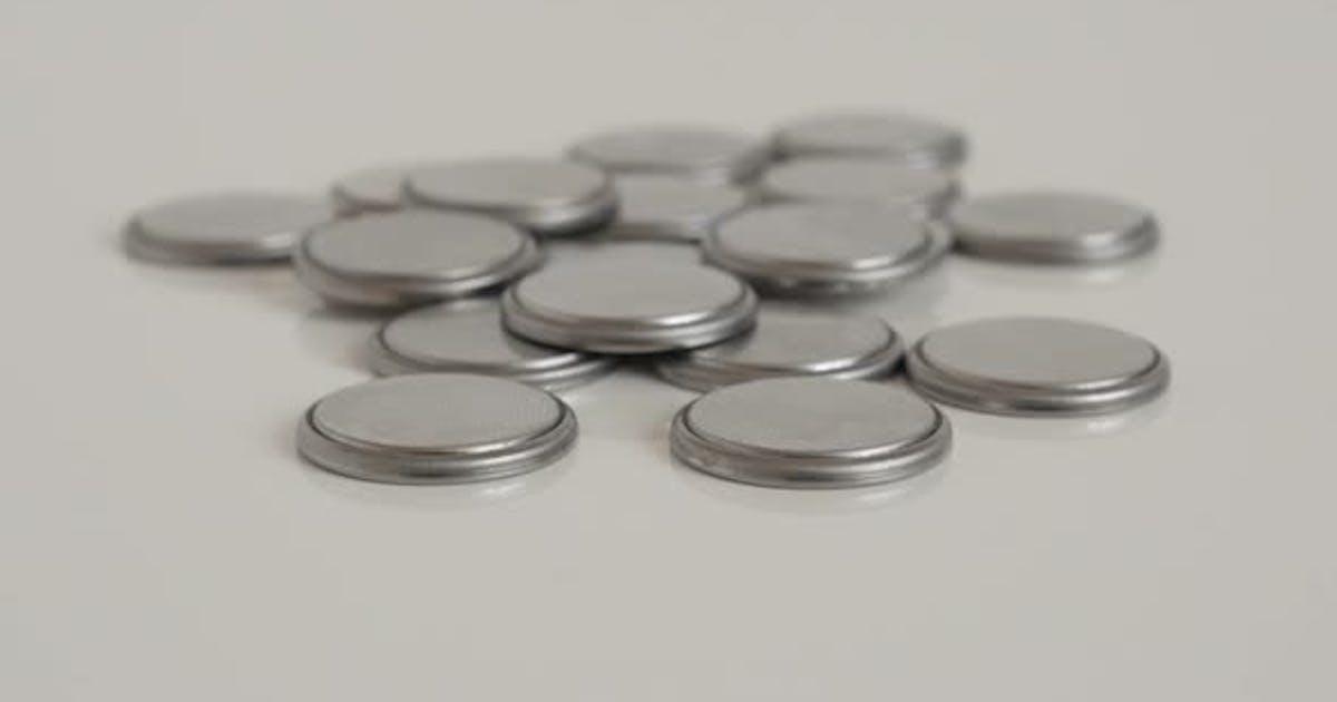 Slow tilt on pile of cell batteries close-up 4K  video