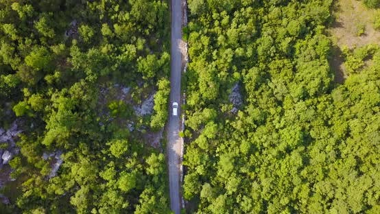 Thumbnail for Aerial drone view of a minivan car vehicle driving on a rural road
