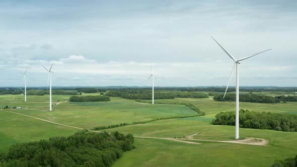 Cover Image for Aerial View of Wind Turbine Farm in Countryside