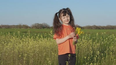 Girl pick flowers in the meadow.