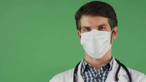 Thumbnail for Cheerful Male Doctor in a Medical Mask Smiling To the Camera