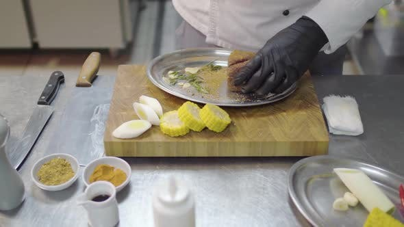 Thumbnail for Professional Chefs Hands in Black Latex Gloves Rubs a Piece of Veal in the Metal Plate, Marinating