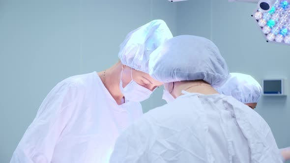 Thumbnail for Medical Team Performing Surgical Operation in Bright Modern Operating Room