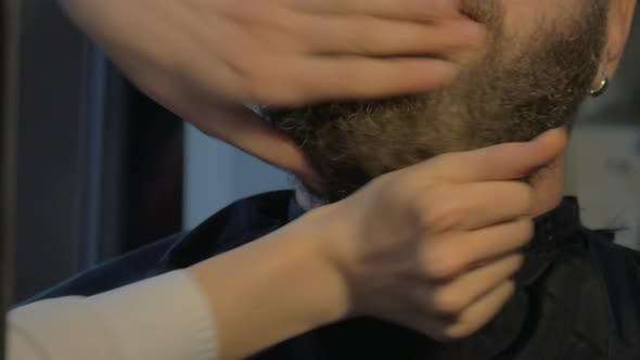 Close up view of woman hands cares of beard