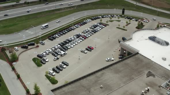 Aerial Drone Shot of the Car Carrier Trailer Car Hauler Loads Cars on the Trailer on Parking of the
