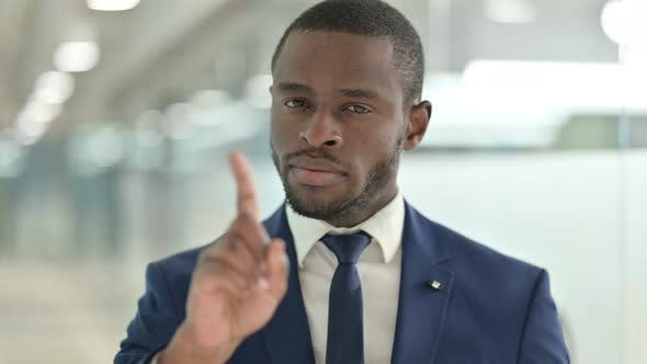 Thumbnail for Portrait of African Businessman Saying No with Finger Sign