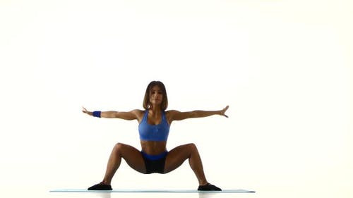 Athlete Bends the Body on the Fitness. White