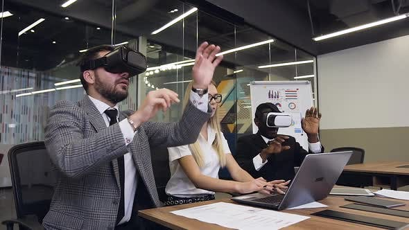 Thumbnail for Two Serious Multiethnic Businessmen Wearing Virtual Reality Headset Making Joint Report