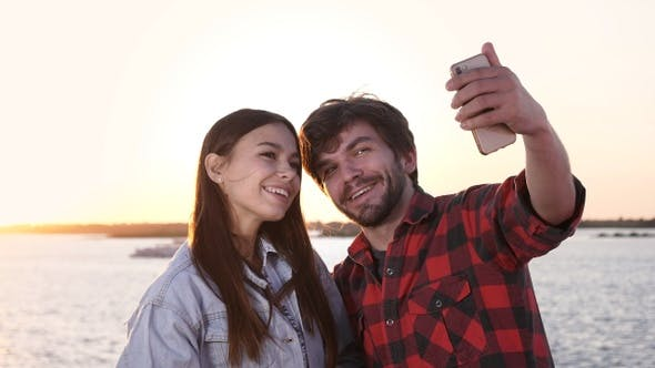 Cover Image for Couple in love taking selfies outdoors