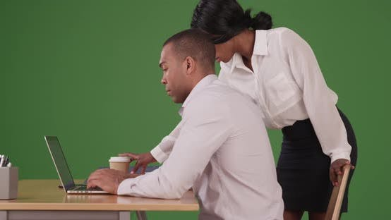 Thumbnail for Two business people working together on problem on green screen