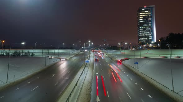 Evening traffic in the city in winter,  time-lapse