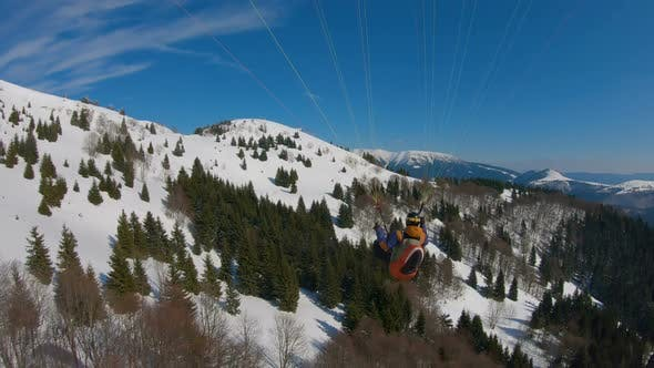 Flying Paragliding in Winter Mountains, Adrenaline Adventure of Freedom Free Flight
