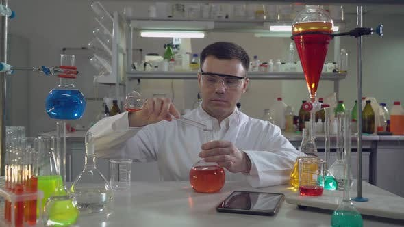 Thumbnail for Handsome Professional Scientist Holding Flask in Lab