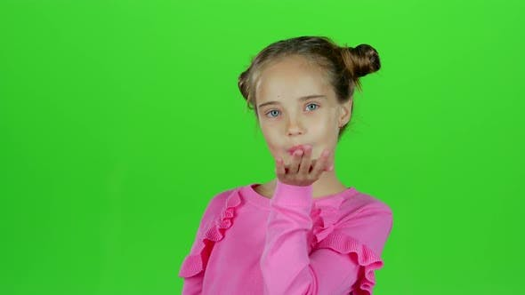 Thumbnail for Child Sends an Air Kiss. Green Screen. Slow Motion