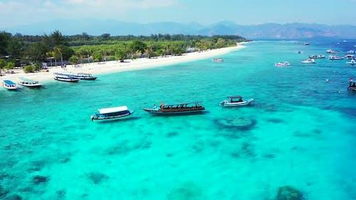 Daytime fly over travel shot of a sunshine white sandy paradise beach and turquoise sea background i