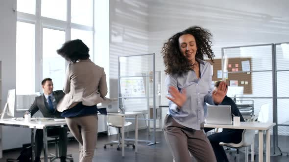 Thumbnail for Young Business Team Dancing in Office