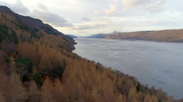 Aerial View of Loch Ness and Surrounding Forests in Scotland