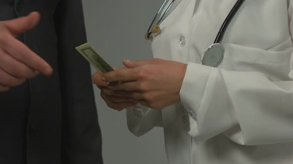 Thumbnail for Businessman Giving Money to Unfair Female Physician, Bribe at Medical Center