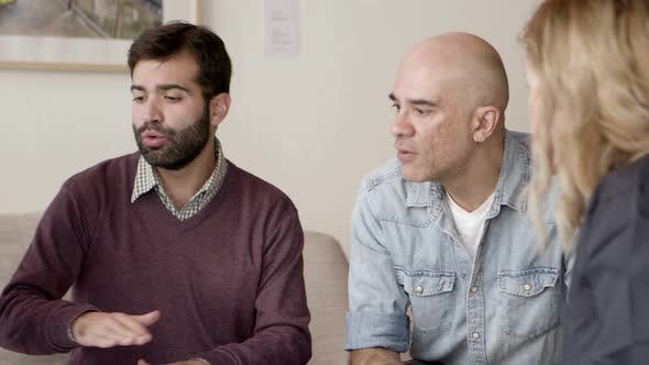 Thumbnail for Concentrated Home Owners Talking with Interior Designer